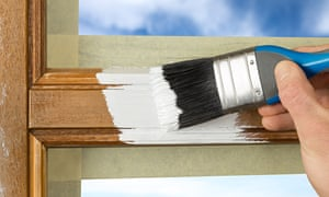 Use tape to mask off areas before painting woodwork