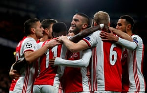 Ajax players celebrate after scoring early at the Bridge.