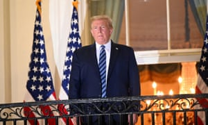 Donald Trump poses on the Truman Balcony of the White House after being released from hospital following coronavirus treatment on October 5 2020.
