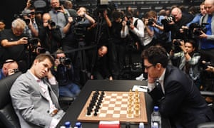 Magnus Carlsen (L) plays against Fabiano Caruana (R) during the World Chess Championship 2018 in London on 26 November 2018