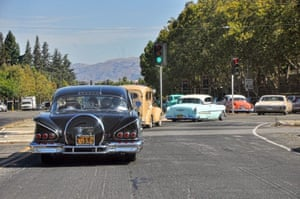 A convoy carries the ashes of Sonny Madrid, co-founder of Lowrider magazine, to the cemetery.