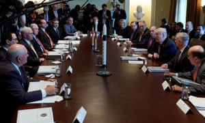 U.S. President Donald Trump holds a cabinet meeting in Washington, with some model rockets.