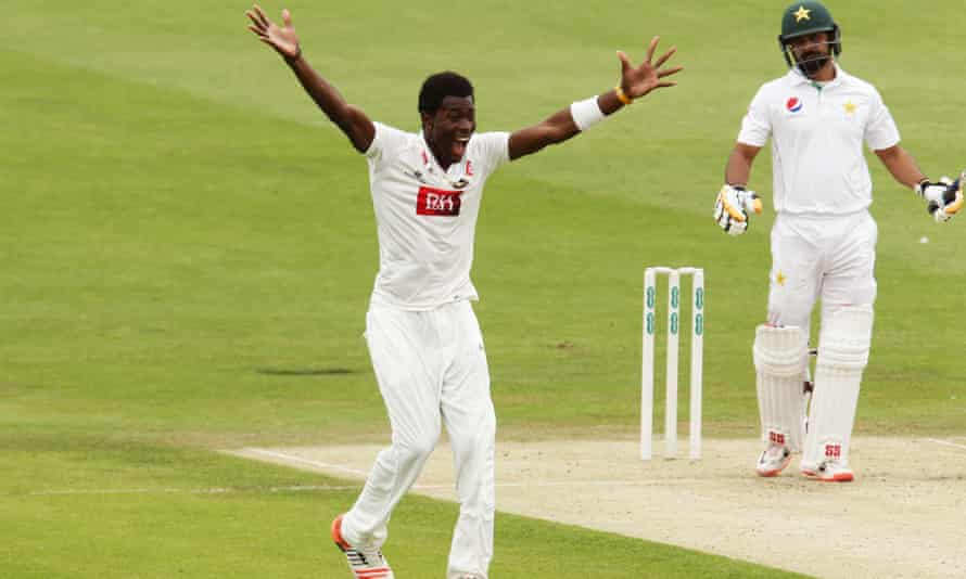 Jofra Archer celebrates taking the wicket of Mohammad Hafeez on his first-class debut for Sussex.