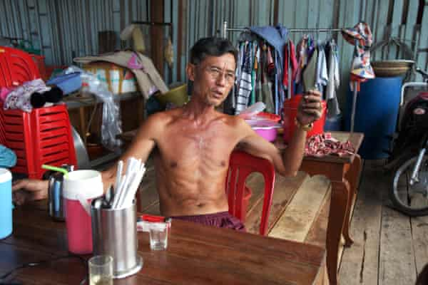 Heng Ngy lives in a wooden house over a sea of plastic.