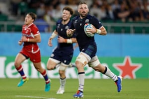 Scotland's flanker John Barclay runs in to score a try.