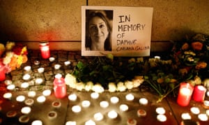 Candles burn to commemorate investigative journalist Daphne Caruana Galizia in Berlin in October.
