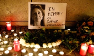 Candles burn to commemorate the killed investigative journalist Daphne Caruana Galizia