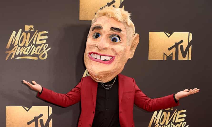 Head case: Mike Posner at the MTV awards, wearing the papier-mache head he wears in the song's video.