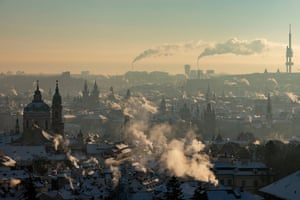 Prague, Czech Republic General view of Prague at sunrise as the smoke rises from chimneys during a freezing winter morning