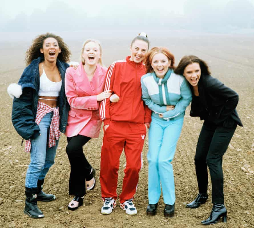 Mel B with Emma Bunton, Mel C, Geri and Victoria on the Spice Girls' first magazine shoot in a muddy field in 1996