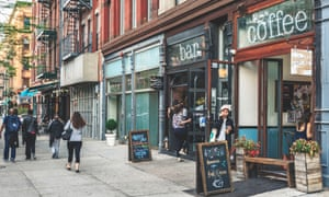 Cafes and bars on a street in Harlem, New York