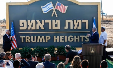 Israel's prime minister, Benjamin Netanyahu (right) and the US ambassador to Israel, David Friedman (left), applaud after unveiling the place-name sign for a new settlement during an official ceremony in the Golan Heights in June last year