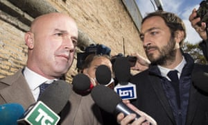 Italian journalists Gianluigi Nuzzi (left) and Emiliano Fittipaldi with media holding out microphones.