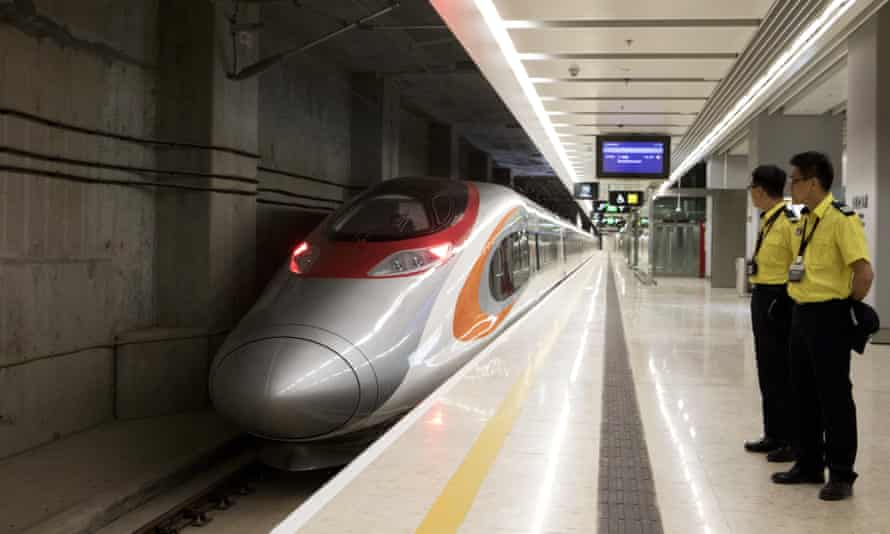 A Vibrant Express train at West Kowloon station.
