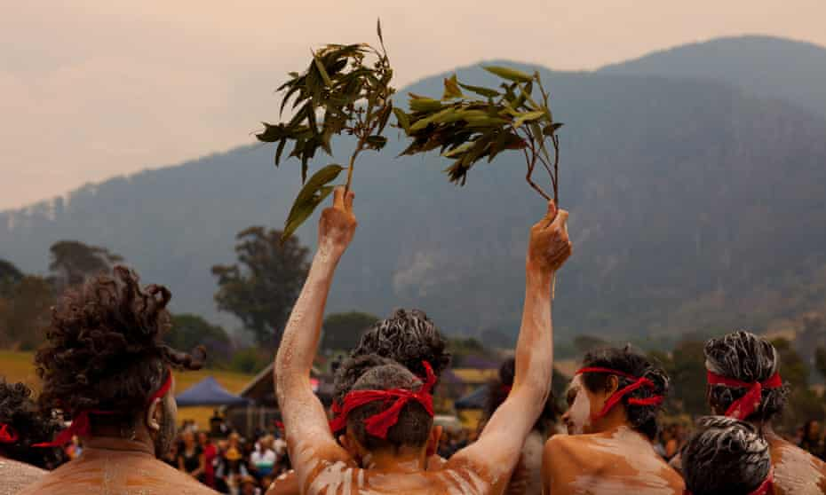 Yuin people gather at Gulaga mountain in early December as smoke clouds the sky, to perform a ceremony to heal the country. Fires swept through the region over the new year period.