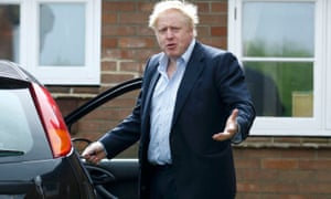 Boris Johnson gestures as he gets into his car at his home in Oxfordshire on Saturday