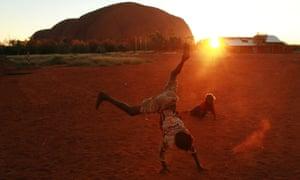Children play near Uluru