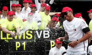 Lewis Hamilton celebrates winning the Monaco Grand Prix with the Mercedes team on Sunday.
