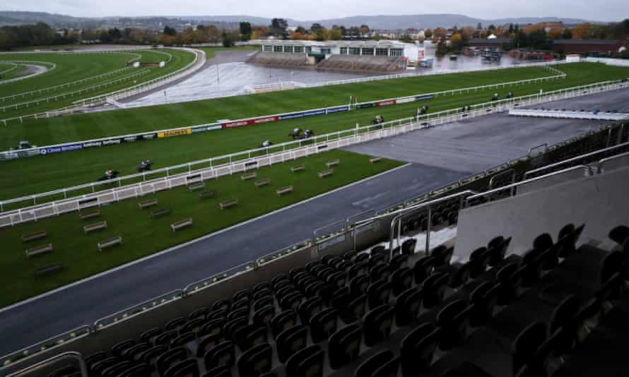 Runners and riders in front of the empty grandstands at Cheltenham.