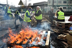 Gilets Jaunes (Yellow vest) protestors man a barricade in Montabon, northwestern France, at an access to an oil depot they block since December 2 as part of the Gilets Jaunes protests.