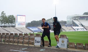 Dom Bess and Jos Buttler look skywards as rain delays day three