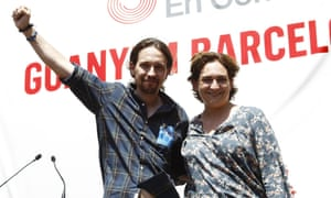 Pablo Iglesias, anti-austerity party Podemos leader, joins Colau at a campaign meeting in Barcelona.