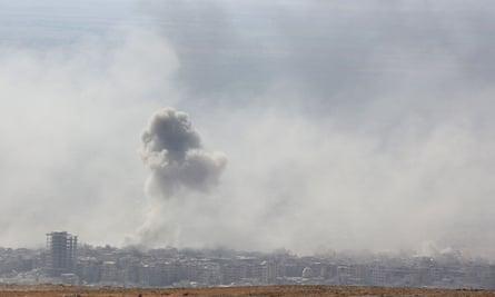 Smoke rises over Douma, Syria
