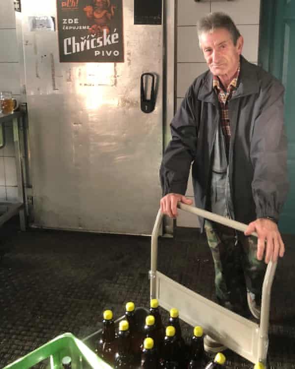 Vašek Stark loads crates for transportation to local pubs.