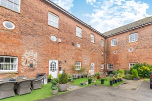 Wicklewood, Norfolk This mid-terrace four-bedroom townhouse is part of a converted Grade II-listed redbrick hospital. Set over three floors with a mezzanine master bedroom boasting a full height glass wall overlooking the lounge/diner, it has some lovely period features inside. The extensive communal grounds include a tennis court and indoor swimming pool. £325,000, Hammondlee, 01953 536950