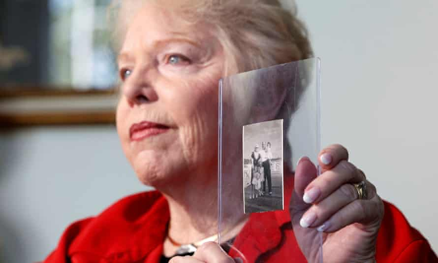 Diane Capone, granddaughter of Al Capone, talks about her memories of him while holding a photo featuring both of them and other family members, taken in 1946.