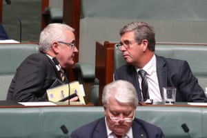 Andrew Wilkie talks to David Gillespie during question time in the house of representatives