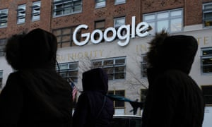 People walk past a Google office building on 9th Avenue in Chelsea district on December 30, 2017 in New York City.