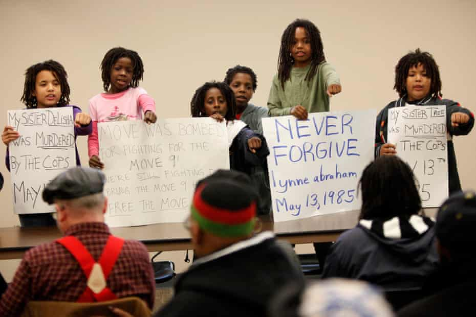 MOVE members' children chant slogans at the start of a news conference in Philadelphia, Wednesday, May 12, 2010. Ramona Africa, a survivor of the 1985 fatal police bombing in Philadelphia, wants to file private criminal complaints charging former city officials with murder.