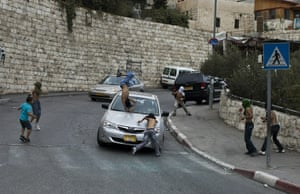 An Israeli motorist runs down a masked Palestinian youth who was among a group of boys throwing stones at Israeli cars in the mostly Arab east Jerusalem neighborhood of Silwan. The boy was injured but his condition was described as stable.