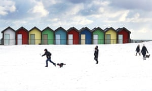 People walk their dogs on Blyth beach in Northumberland
