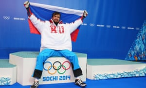Alexander Tretiakov, one of Russia's 13 gold medallists at the Sochi Winter Olympics in 2014, celebrates winning the skeleton gold medal.