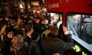 Commuters attempt to board a red London bus near Charing Cross Underground station in London on 9 January 2017, after a 24-hour tube strike was set to end.