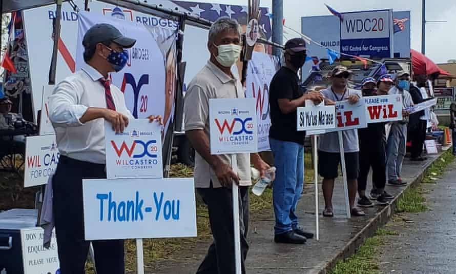Wil Castro (left, in mask) campaigning as the Republican candidate for Guam's representative seat. Despite being US citizens, residents of Guam are not able to vote for president. In place of actual voting, the island does a presidential 'straw-poll', which is an accurate barometer of the national vote.