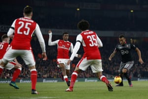 Bertrand shoots through the Arsenal defence to score the second.