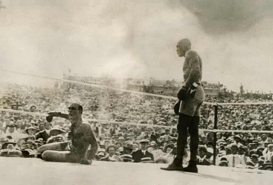 Jack Johnson, right, knocks out Jim Jeffries in Reno, Nevada, 4 July 1910.