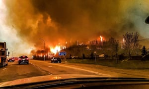 A mobile phone image of the wildfire raging through the Canadian city of Fort McMurray on 3 May.
