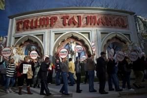 Union members from UNITE HERE Local 54 rally outside the Trump Taj Mahal Casino in Atlantic City, New Jersey.