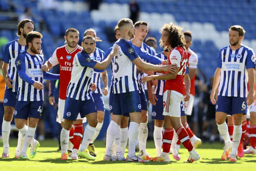 Brighton and Arsenal players square up at the final whistle