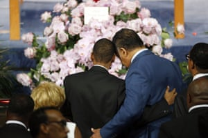The Rev Jesse Jackson, right, consoles a family member as they pause at the casket.