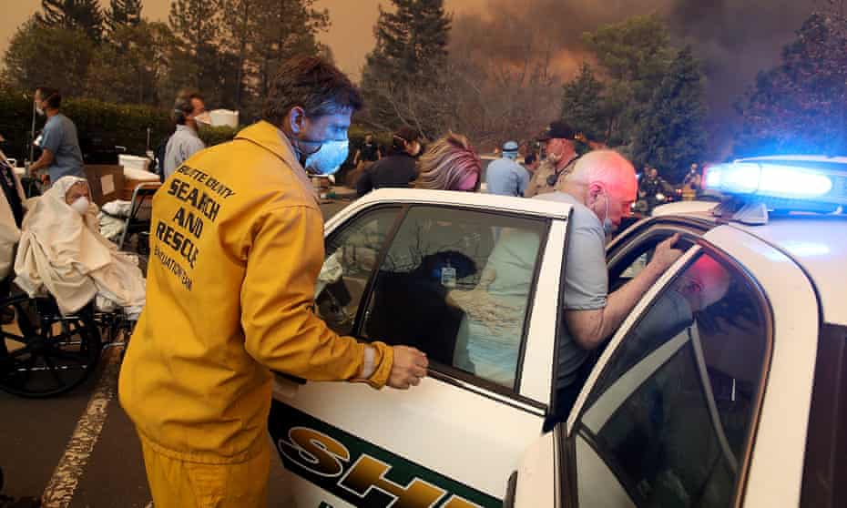 Hospital workers and first responders evacuate patients from the Feather River hospital as the Camp Fire moved through the Paradise area last week.