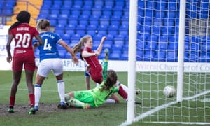 Amy Rodgers of Liverpool slides in to score the third goal in their 3-1 win over Everton Ladies in their WSL match at Prenton Park in May 2019.