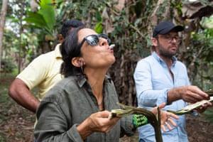Local activist Bia Saldanha eats inga fruit seeds.