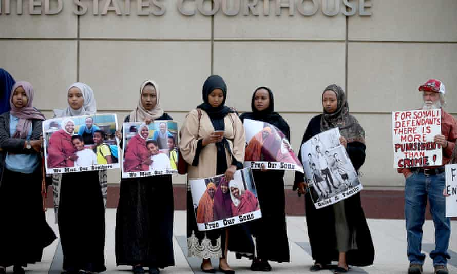 Supporters and family members of the Somalian American men accused of trying to join Isis protest outside the federal courthouse in Minneapolis.