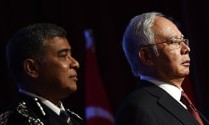 Malaysia's prime pinister Najib Razak , right, and his police chief Khalid Abu Bakar. The opposition says the new security laws could be used to silence critics.