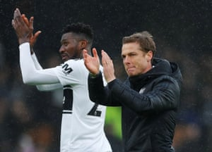 Anguissa and caretaker manager Scott Parker applaud fans after Fulham loose 1-2 to Chelsea.
